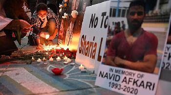 Iranisches Regime zerstört Grab des hingerichteten Ringers Afkari