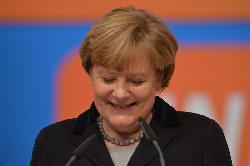 Angela Merkel im Wunderland aufwecken